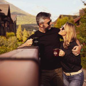 Man hugging woman manifesting love and having coffee.
