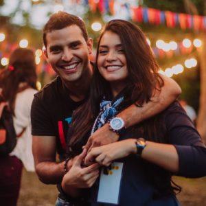 Man wearing t-shirt hugging woman manifesting love.