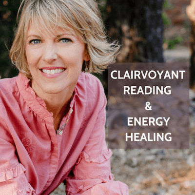 Psychic healer Elizabeth Hunter Diamond, in a pink shirt, offers clairvoyant reading and energy healing sessions.