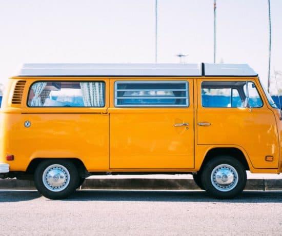 Yellow van in a parking lot.