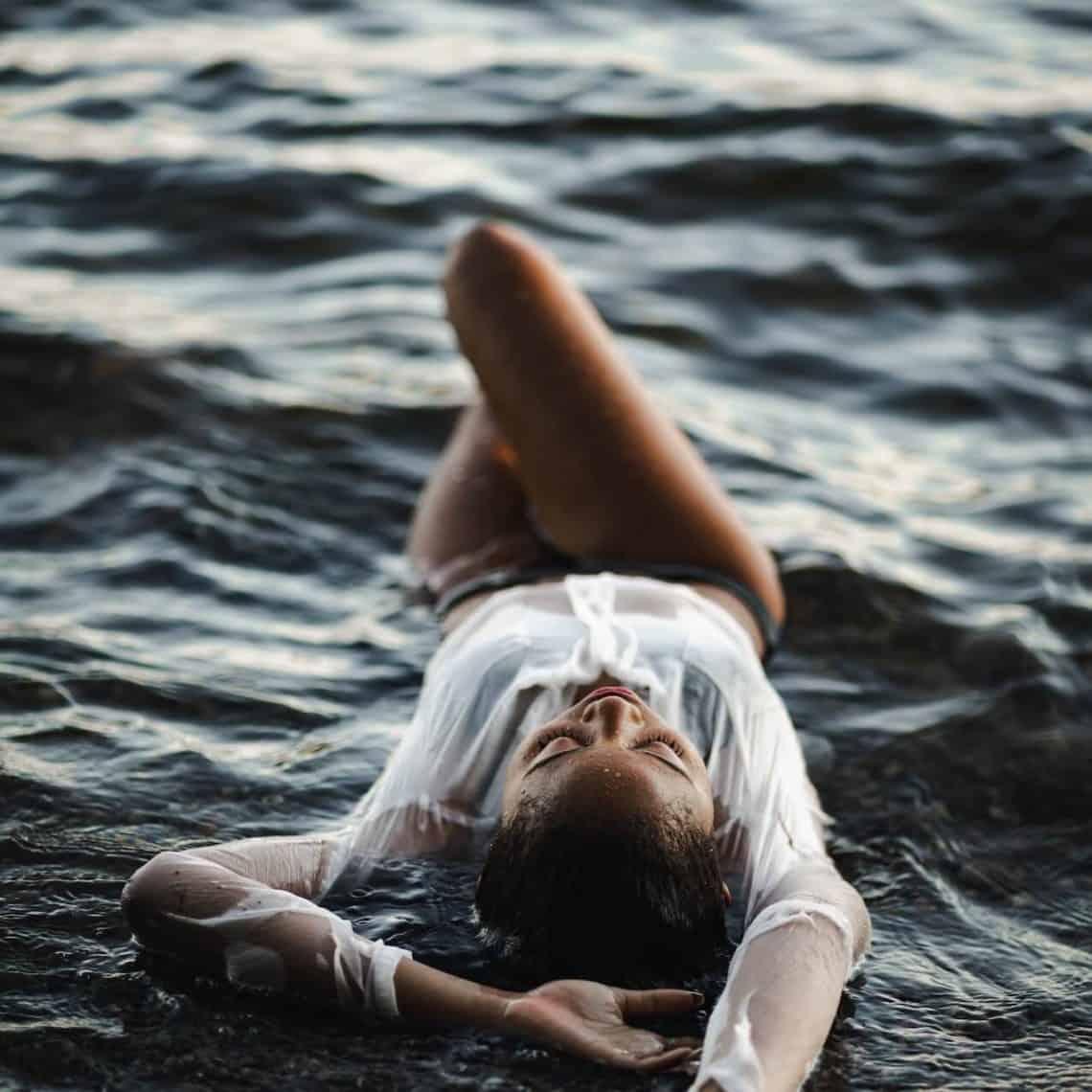 Sacral chakra woman in water enjoying pleasure and self-love.