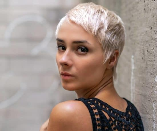 Woman empath, with short blond hair and wearing a black top, turns and looks at you. When you know the triggers for empaths to watch you can activate your boundaries.