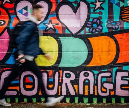 "A wall of colorful graffiti with ""courage"" spelled out."